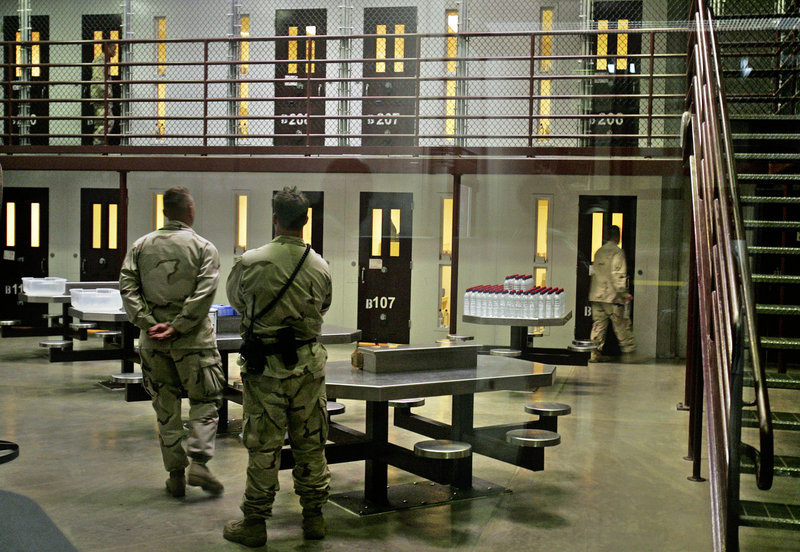 Guards keep watch over a cell block with detainees in the Camp 6 maximum-security facility at Guantanamo Bay U.S. Naval Base, Cuba, in this 2007 photo.
