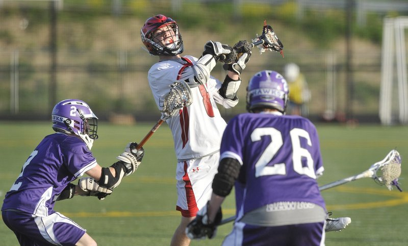Scarborough's John Wheeler leaps over the Marshwood defense to score one of his Class A-leading 51 goals last season. Back for his senior year, Wheeler is one reason the perennial powerhouse Red Storm are talking about a fourth consecutive championship. Wheeler, an All American selection, had 31 assists last year.