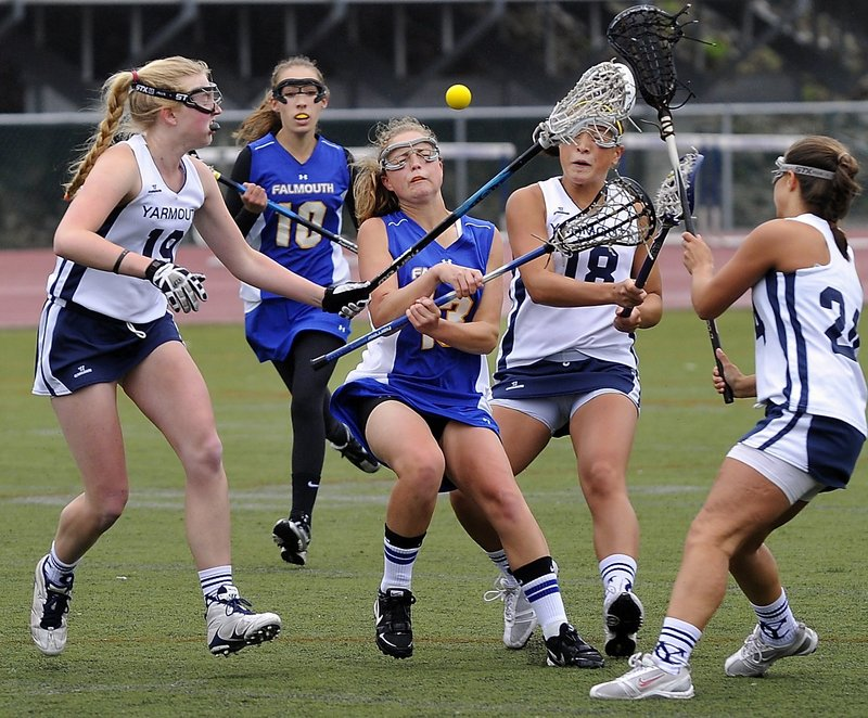 Falmouth's Alex Bernier, center, typically attracts a crowd of defenders, as she does here against Yarmouth. A high school All-American last year, she racked up 33 goals and 37 assists in leading the Yachtsmen to the Western Class B semifinals.