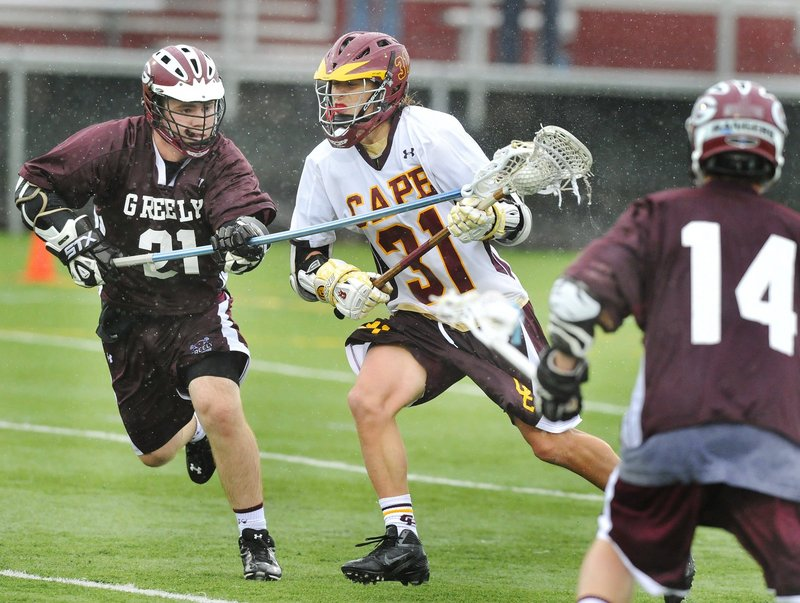 Cape Elizabeth's Alex Bornick, 31, shown vying for position against Greely's Tim Storey last year, is among the players who should keep the Capers among the 2013 contenders.