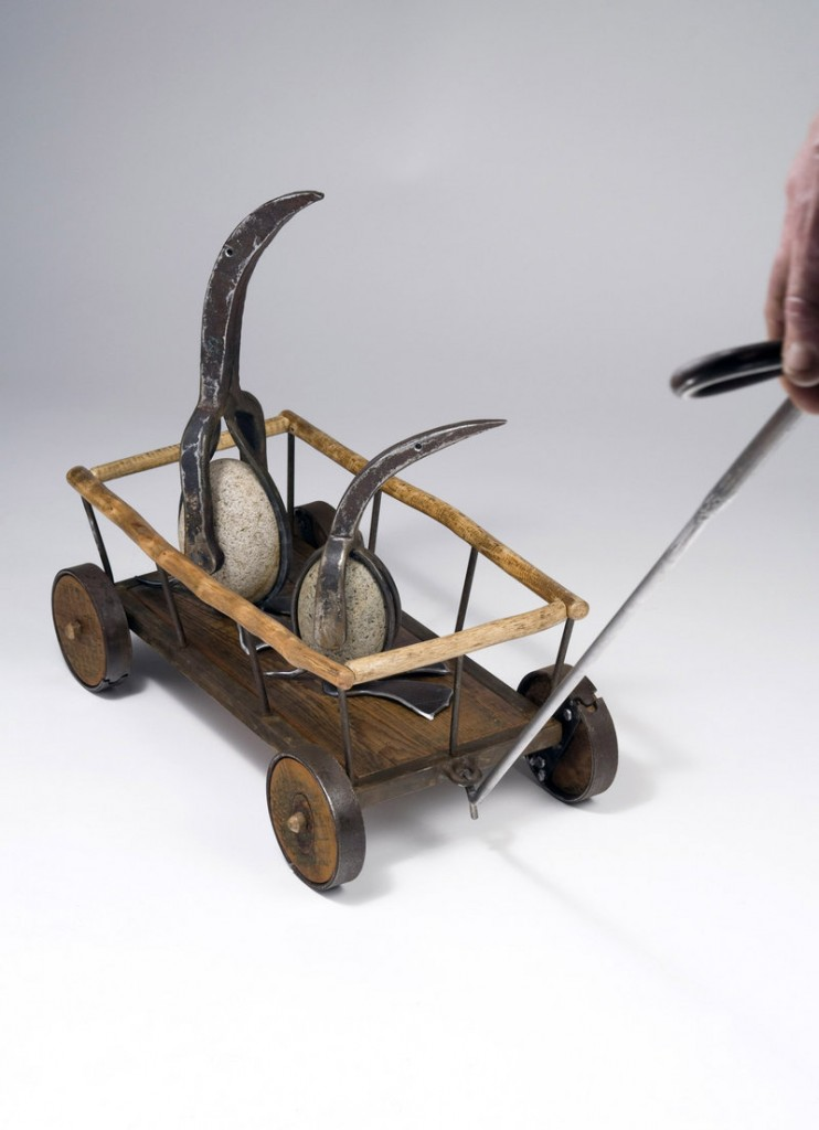 "Patrick Plourde's ""Penguins in Hay Wagon Pull Toy,"" 2013, vintage tools, steel, stones, wood."