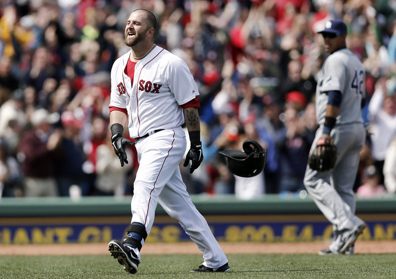 Boston's Mike Napoli celebrates after his ninth-inning double brought home Dustin Pedroia with the winning run Monday afternoon during the annual Patriots Day game at Fenway Park.