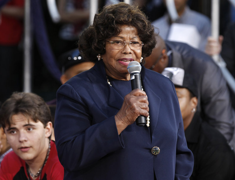 Katherine Jackson is shown at a 2012 ceremony honoring her son, Michael Jackson. His son, Prince Michael Jackson, is at left. Jury selection began Monday in a civil trial against concert giant AEG Live.