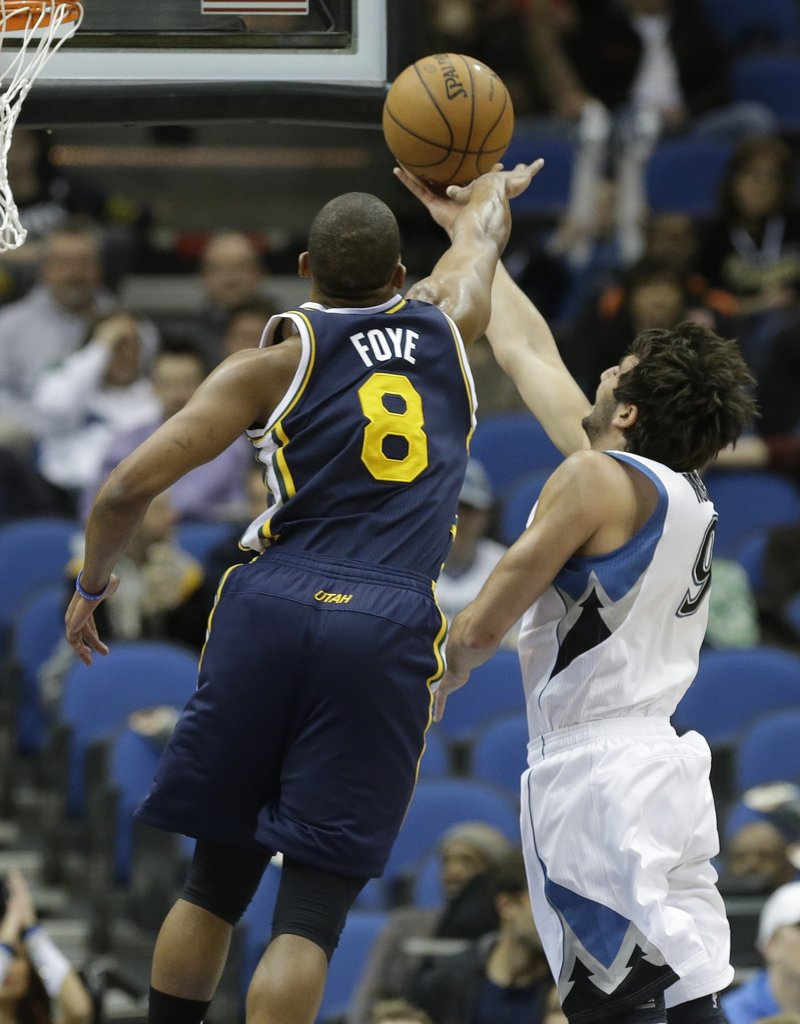 Utah's Randy Foye tries to block a layup by Minnesota's Ricky Rubio in the first quarter of a 96-80 win by the Jazz at Minneapolis on Monday. The win was a critical one for Utah, which is trying to avoid elimination from the playoffs.