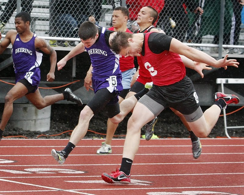 Alex Shain of Sanford, right, will be returning for his senior season in an attempt to repeat as the Class A state champion in the 100 meters. Shain, also a top football and basketball player, captured the triple jump at last year's state meet.