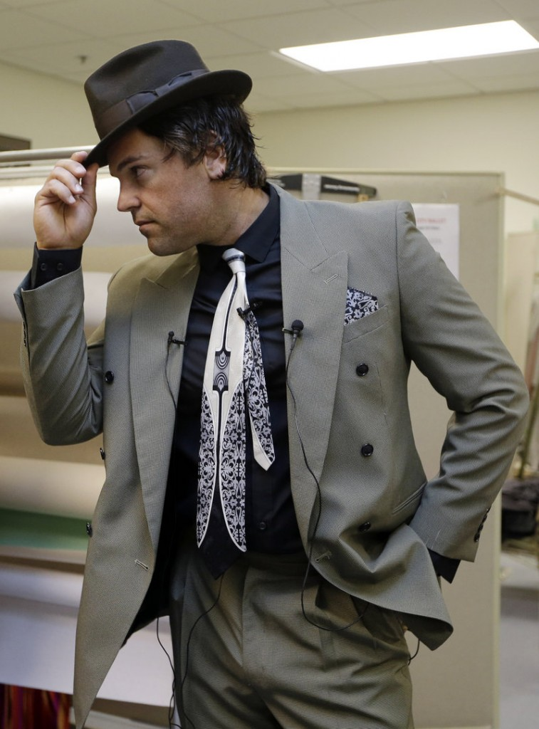 "Mike Piazza strikes a pose as he is fitted for his costume for his role in ""Slaughter on Tenth Avenue"" in Miami Beach."
