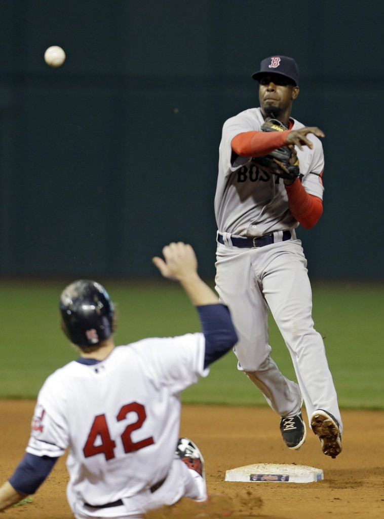 Pedro Ciriaco of the Boston Red Sox fires over Mark Reynolds of the Cleveland Indians to complete a double play in the eighth inning Tuesday night. Boston won, 7-2.