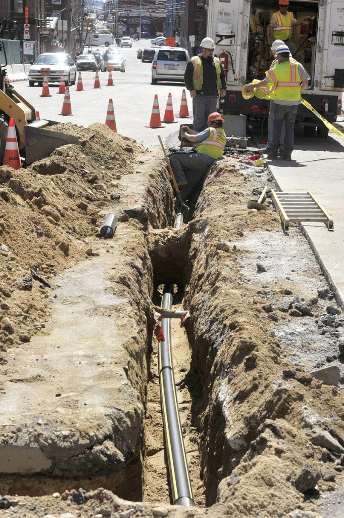 In this Wednesday, April 17 photo, crews install new natural gas lines in Portland's Old Port district on Temple Street. Unitil says it needs to raise prices to offset rising construction costs and other expenses related to distribution.