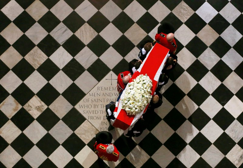 The coffin of Margaret Thatcher arrives for a ceremonial funeral at St. Paul's Cathedral in London on Wednesday.