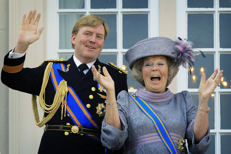 Queen Beatrix and Crown Prince Willem-Alexander wave to well-wishers from the balcony of Royal Palace in The Hague, Netherlands, in 2010.
