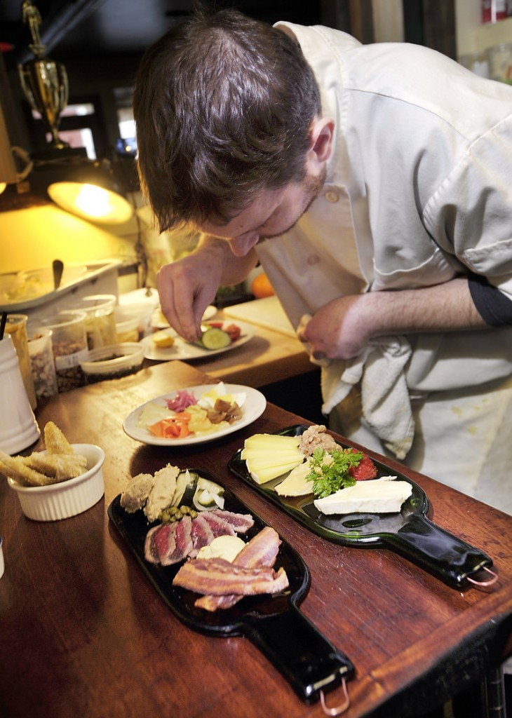 Line chef Kevin Heenan prepares the platters, which are offered on the pub menu. The restaurant also offers a dinner menu.