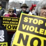 Supporters of gun control measures hold signs on the steps of the Colorado State Capitol in Denver on Thursday during a rally to honor U.S. victims of gun violence since the 1999 Columbine High School shooting.