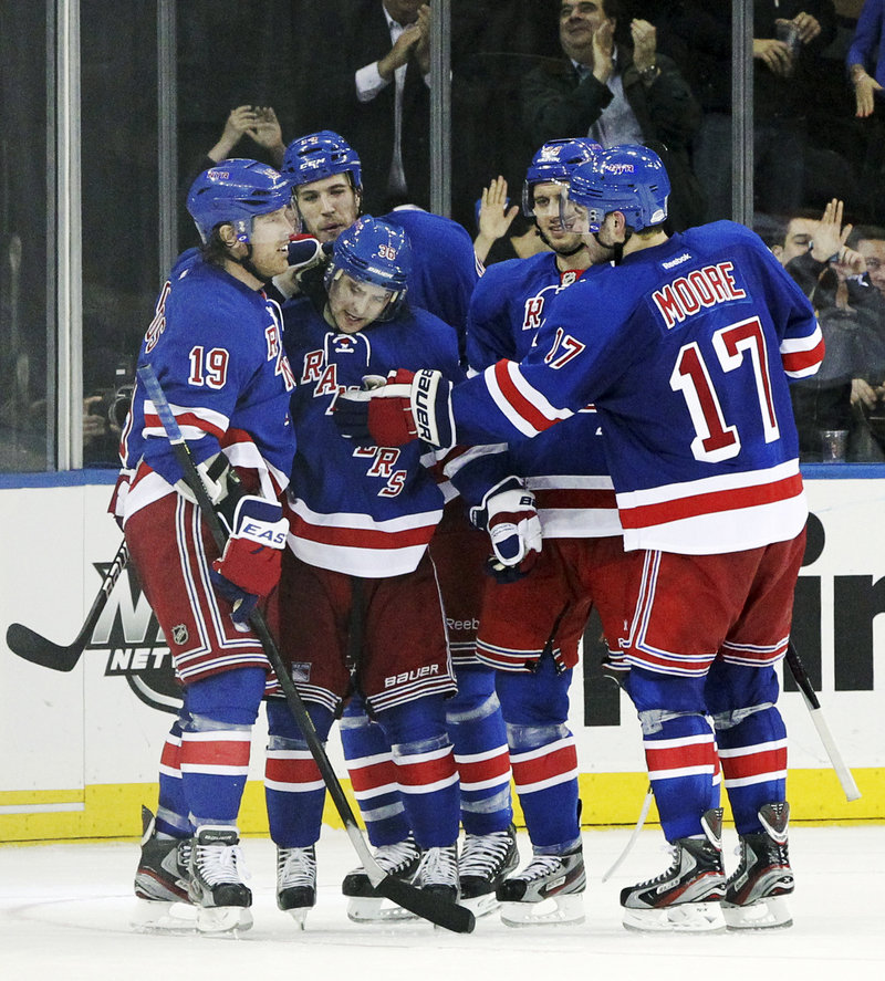 Mats Zuccarello, second from right, is congratulated by his Rangers teammates after a third-period goal during New York's 6-1 rout of Florida on Thursday night.
