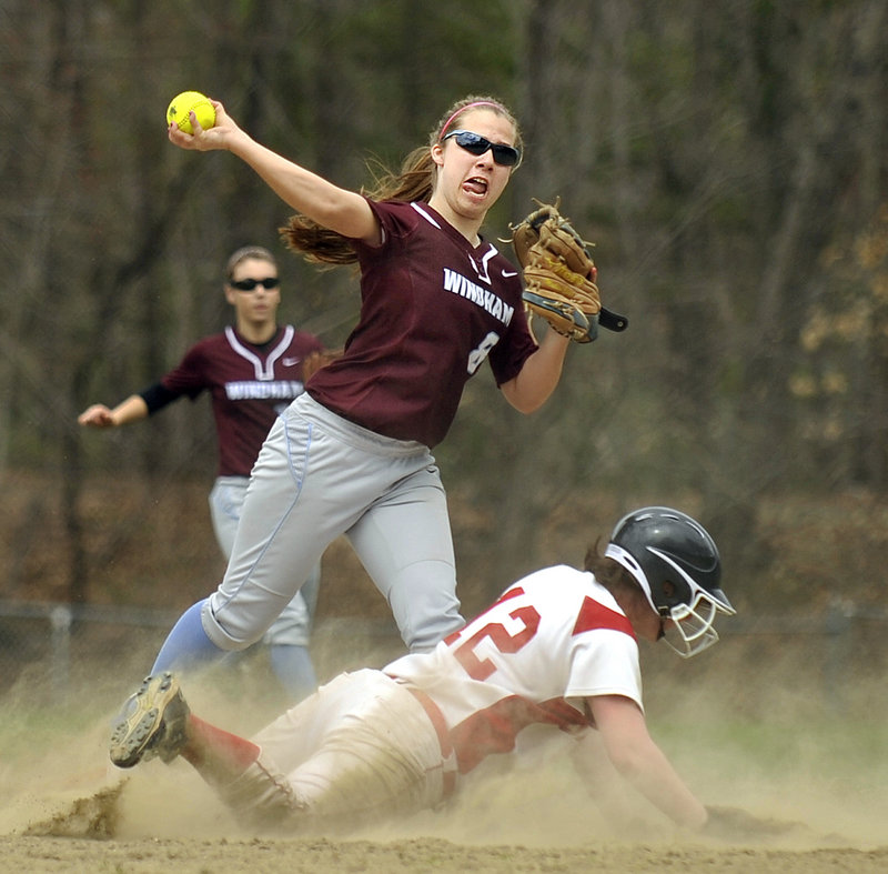 Madison Elliott of Windham attempts to turn a double play Friday as Jen Jones of Sanford slides into second base during their SMAA softball opener. Windham came away with a 5-0 victory.