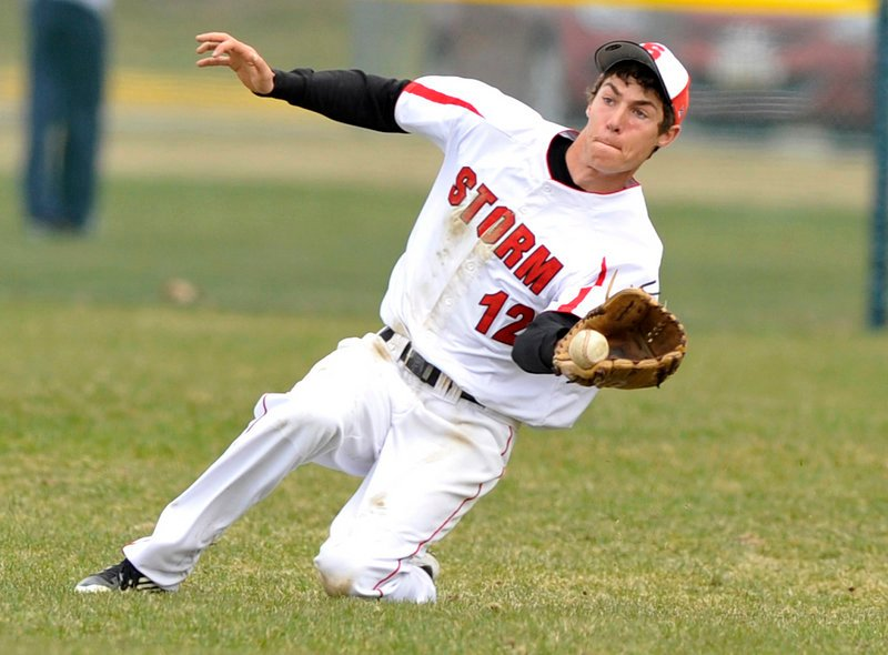 Center fielder Greg Viola of Scarborough makes a sliding catch of a fly ball Friday in the fourth inning of the Red Storm's 3-0 victory against Thornton Academy.
