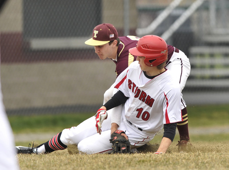 Sam Terry of Scarborough is tagged out by Thornton third baseman Drew Lavigne while attempting to steal in the fourth inning of their opener.
