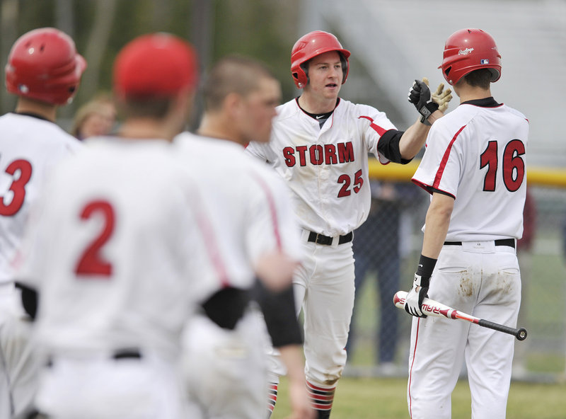 Ben Greenberg of Scarborough is greeted by teammates, including Trevor Sparda, right, after scoring in the sixth inning Friday, the final run in a 3-0 victory against Thornton Academy. Greenberg also pitched a two-hitter with eight strikeouts.