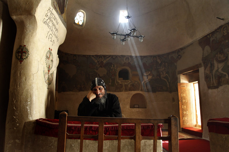 A monk at St. Anthony's Monastery in Egypt smiles serenely while, in turbulent times, his brethren are apt to be more politically assertive.