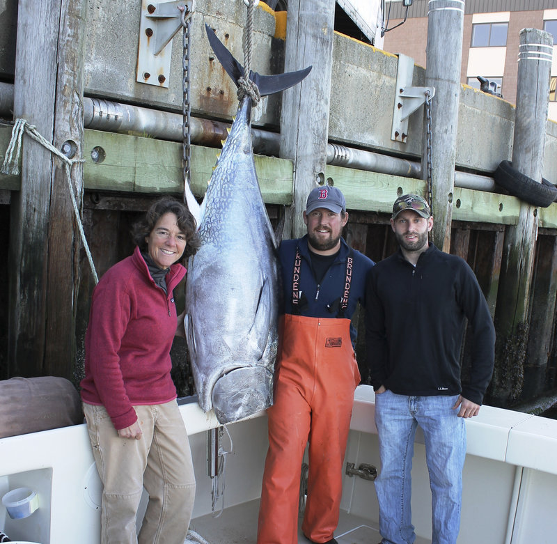 Captains Linda Greenlaw and Rob Evon and first mate Brandon Pierce with a 74-inch bluefin that sold at auction in Tokyo last year for $4,000.