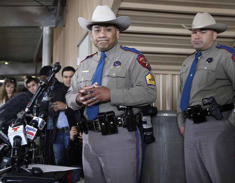 Texas Department of Public Safety Sgt. Jason Reyes, left, and Trooper Noey Fernandez inform reporters of the death toll during a news conference Friday in West, Texas.