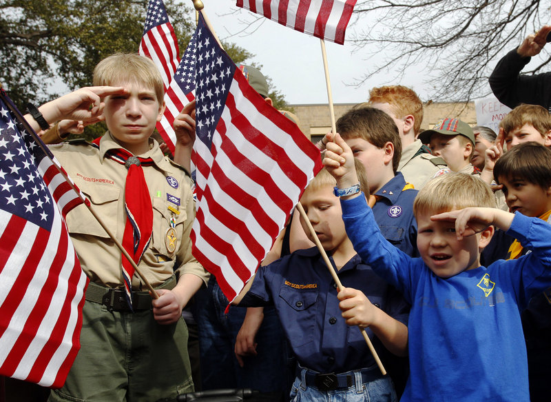"From left, Joshua Kusterer, 12, Nach Mitschke, 6, and Wyatt Mitschke, 4, take part in a ""Save Our Scouts"" rally at the Boy Scouts of America National Headquarters in Dallas, Texas. The organization announced Friday that it will submit a proposal to lift a ban on homosexuals for members but continue to exclude gays as adult leaders."