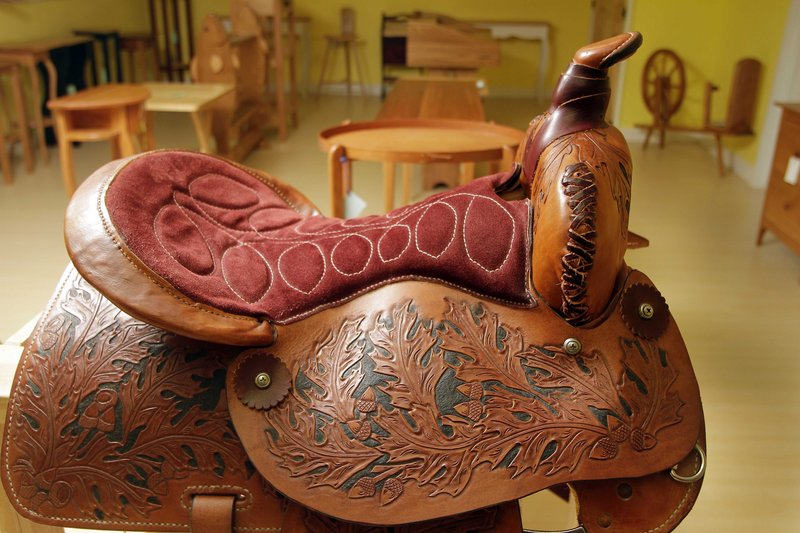 A saddle made by a New Hampshire state prison inmate is seen ready for sale Friday in Franklin, N.H. at the state prison.