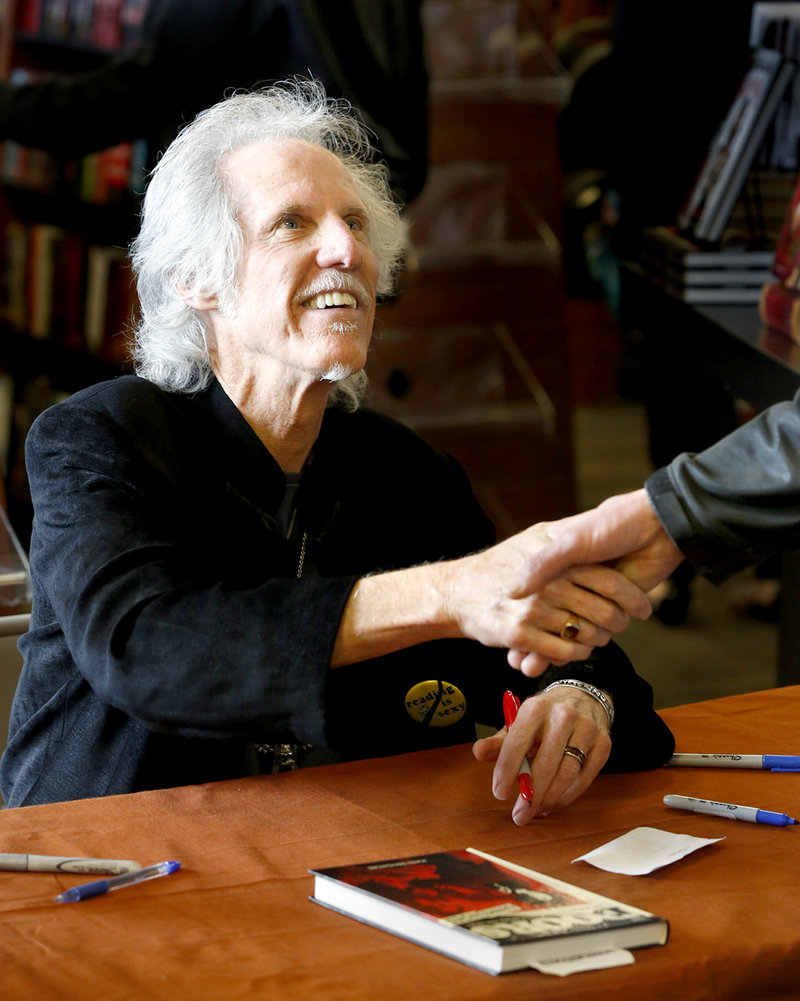"John Densmore greets a fan while signing copies of his book, ""The Doors Unhinged,"" at Bull Moose in Scarborough on Saturday."