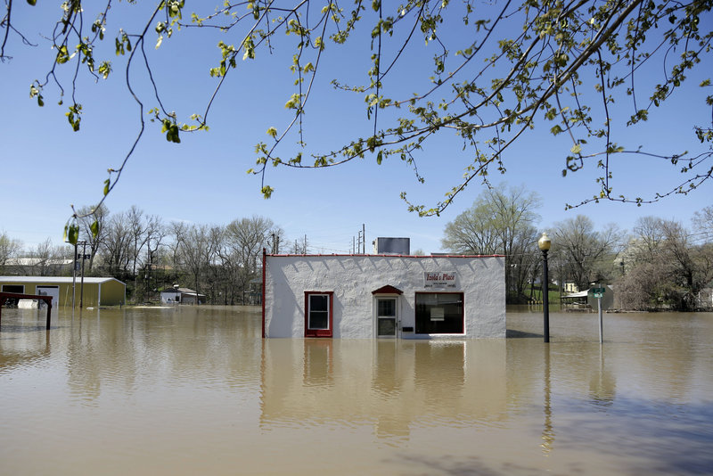 "A restaurant is surrounded by floodwater Saturday in Louisiana, Mo. Communities along the Mississippi and other Midwestern rivers are facing ""major"" and possibly record flooding."