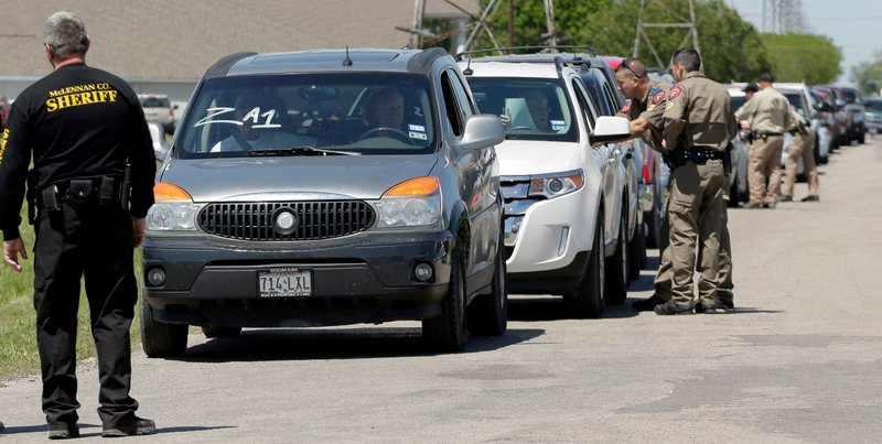 Displaced residents wait at a checkpoint Saturday as they wait to visit their homes.