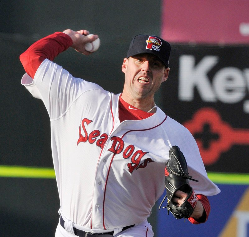 John Lackey throws one of his 67 pitches in a rehab start in Portland on Monday. The pitcher then stayed in the dugout for a couple of innings, and later treated the Dogs to a steak and lobster meal.