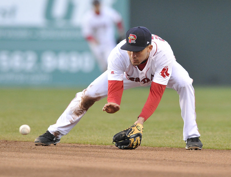 Derrick Gibson shows textbook feet-and-hands form at second base for the Sea Dogs, fielding a grounder in the third inning of Monday's win at Hadlock.