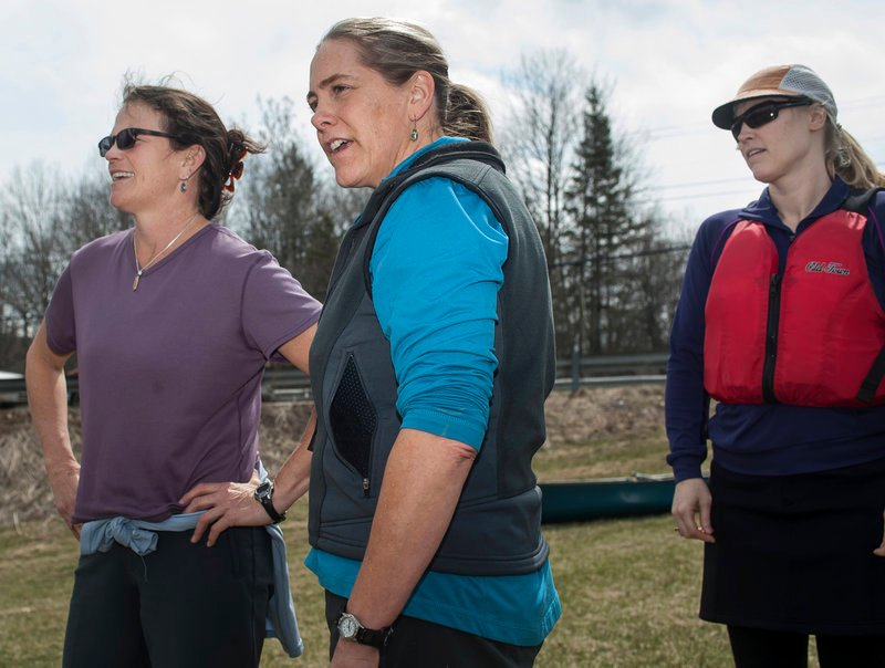 Tammy Kelley, center, and crew mates Ander Thibaud, left, and Leslie Winchester try to figure out the best course to take through obstacles on the low-water Kenduskeag Stream.