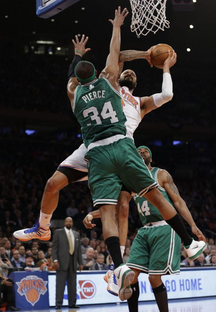 Paul Pierce of the Boston Celtics tries to prevent Tyson Chandler of the New York Knicks from getting to the basket Tuesday night during New York's 87-71 victory.