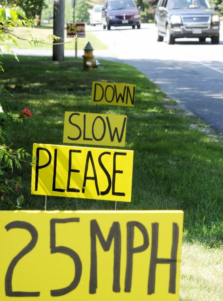 Signs warning motorists to keep to the posted speed limit dot Washington Avenue in Portland in 2010. Speeding is one of the myriad driving infractions that is rampant in Maine, a reader says.