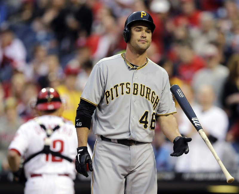 Garrett Jones of the Pirates throws his bat away in disgust after striking out against Roy Halladay of the Phillies in Wednesday night's game at Philadelphia. The Pirates won, 5-3.