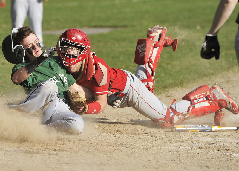 Corey Leach of Bonny Eagle, left, collides with Sanford catcher Ethan Gouin while attempting to score in the fifth inning Thursday during Bonny Eagle's 8-2 victory at Standish. Leach, who drove in two runs in the game, scored when the ball got away.
