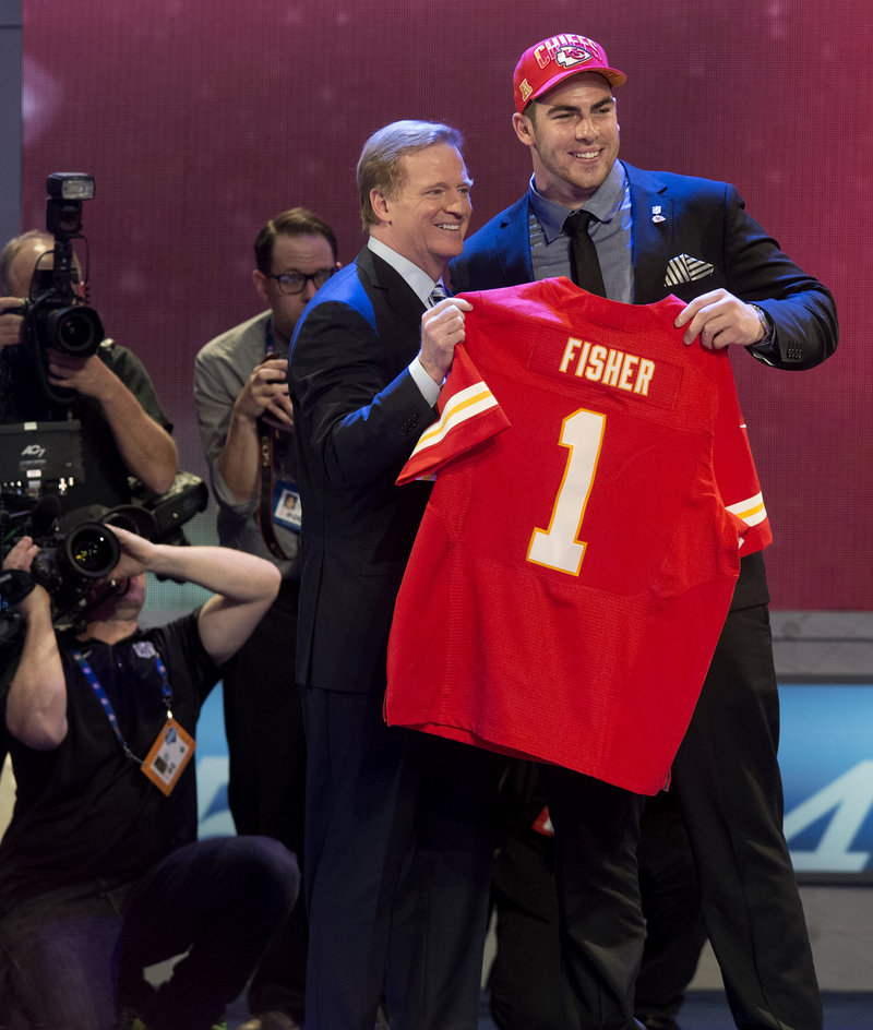 Eric Fisher, with Commissioner Roger Goodell, started the surge of lineman selections, picked at No. 1 by Kansas City.