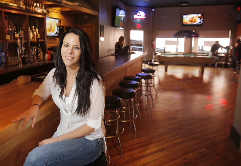 Tracie Cyr is the bar manager at Fatboys Saloon, a new biker bar in downtown Biddeford. Cyr poses for a photo at the bar on Friday, April 26, 2013.