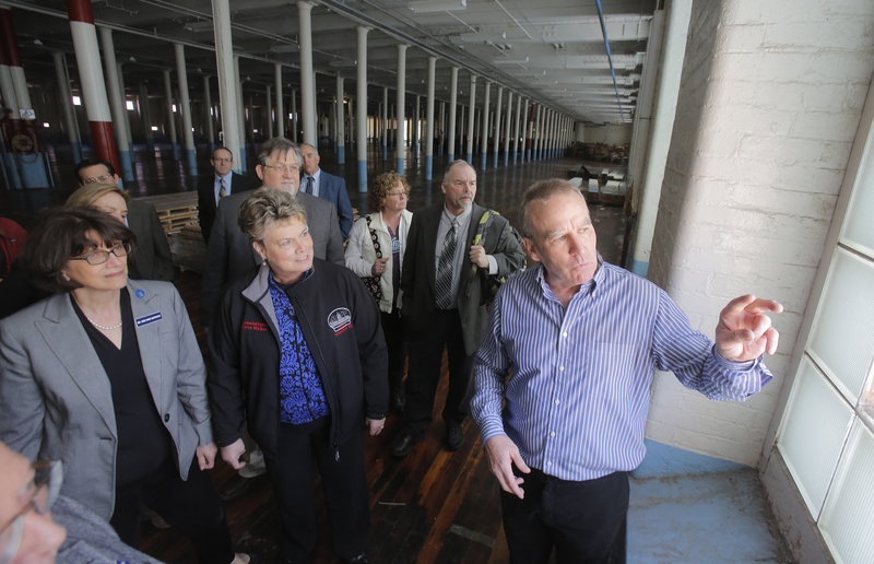 Doug Sanford, right, has the attention of members of the Joint Select Committee on Maine's Workforce and Economic Future as he leads a mill tour.