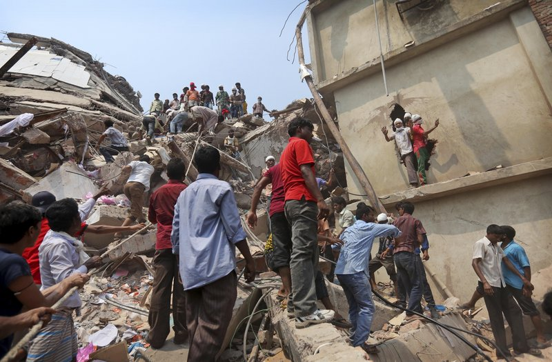Bangladeshi rescuers work Friday at the site of a building that collapsed Wednesday in Savar, near Dhaka, Bangladesh.