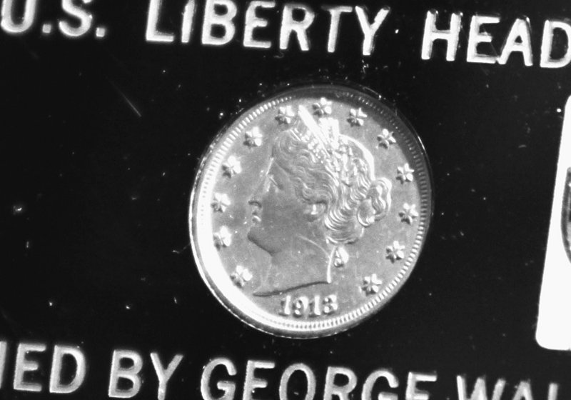 This 1913 Liberty Head nickel was sold to two bidders for $3.17 million at an auction Thursday night in suburban Chicago. Four siblings from Virginia will share the proceeds from the family heirloom.