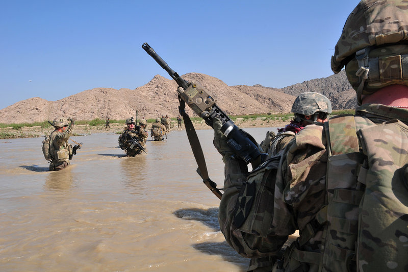U.S. soldiers cross the Tarnak River in Kandahar province, Afghanistan, earlier this month. April has already been the worst month for combat deaths so far this year, with 474 people killed in violence around the nation.