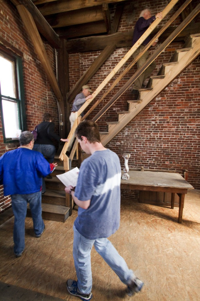 People tour the Biddeford City Hall clock tower during an event Saturday.