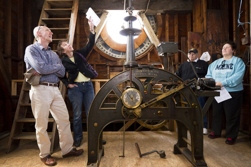 """Judy Beauchemin of Saco points something out to her husband, Jay, while on a tour of the Biddeford City Hall clock tower during the """"Secret Spaces/Haunted Places"""" event Saturday. Donald and Gerri Paquette of Biddeford look on at right."""