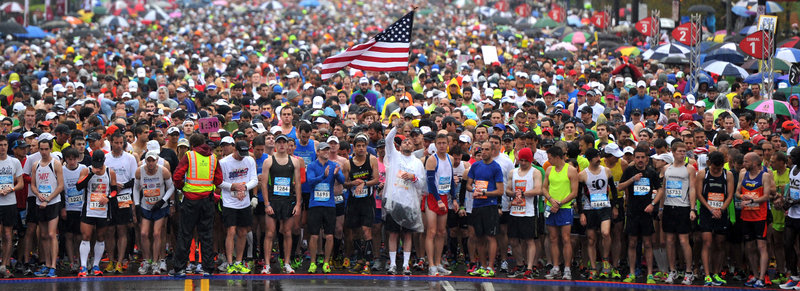 Runners in the St. Jude Country Music Marathon in Nashville, Tenn., observe a moment of silence for those injured and killed in the Boston Marathon bombings.