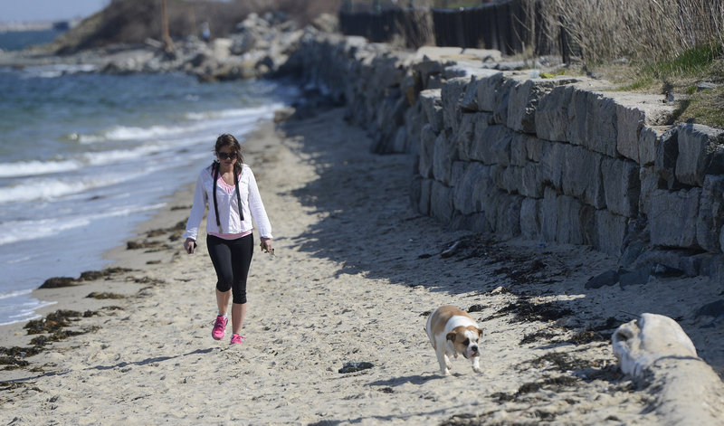 Chanel Bastille of Portland walks with her dog Coco, a bulldog, at East End Beach in Portland Monday, April 29, 2012.
