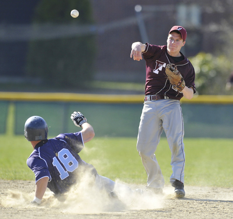 Second baseman Dan Burke of Freeport fires to first Monday after forcing Alex Mercurio of York in the third inning. The Falcons were unable to complete the double play. York won the Western Maine Conference game, 5-3.