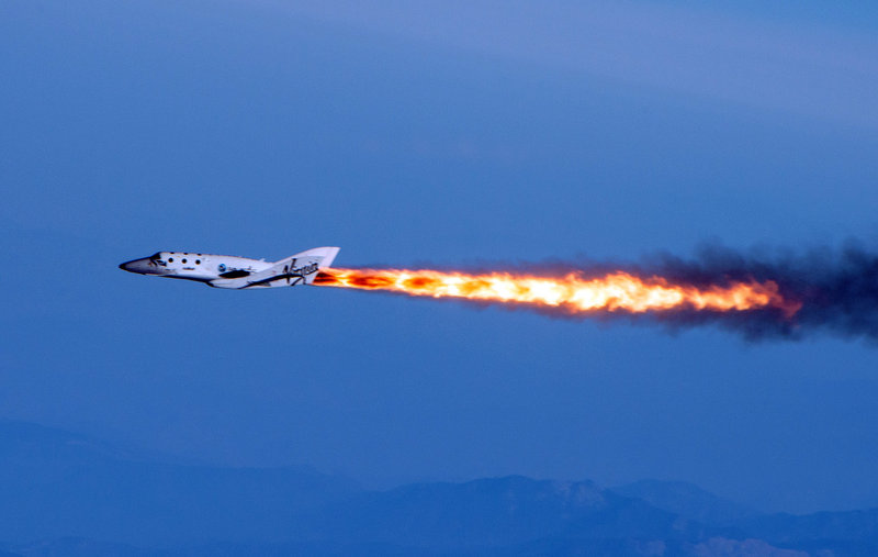 SpaceShipTwo flies under rocket power over the Mojave Desert on Monday, in this photo provided by Virgin Galactic. The spaceship is bankrolled by British tycoon Sir Richard Branson and an Abu Dhabi investment company.