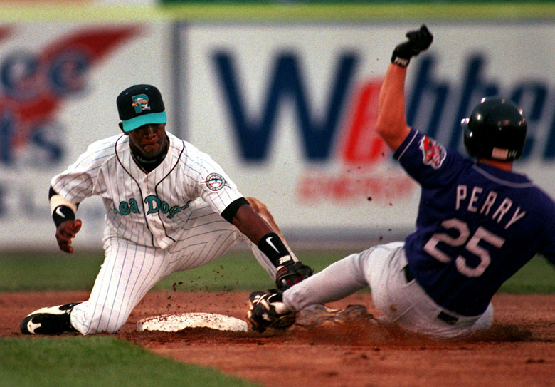 STAFF PHOTO BY GORDON CHIBROSKI -- Monday, August 11, 1997 -- Seadogs' 2nd baseman, Ralph Milliard, puts the tag on Chan Perry of the Akron Aeros as he tried to stretch a single into a double. Action in second inning at Hadlock Field in Portland. Gordon Chibroski