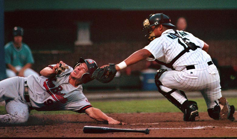 STAFF PHOTO BY JOHN PATRIQUIN -- Wednesday, June 24, 1998 -- New Britain #9 Chad Allen is tagged out at home by Sea Dogs catcher Hector Kuilan during action at Hadlock Field in Portland tonight.